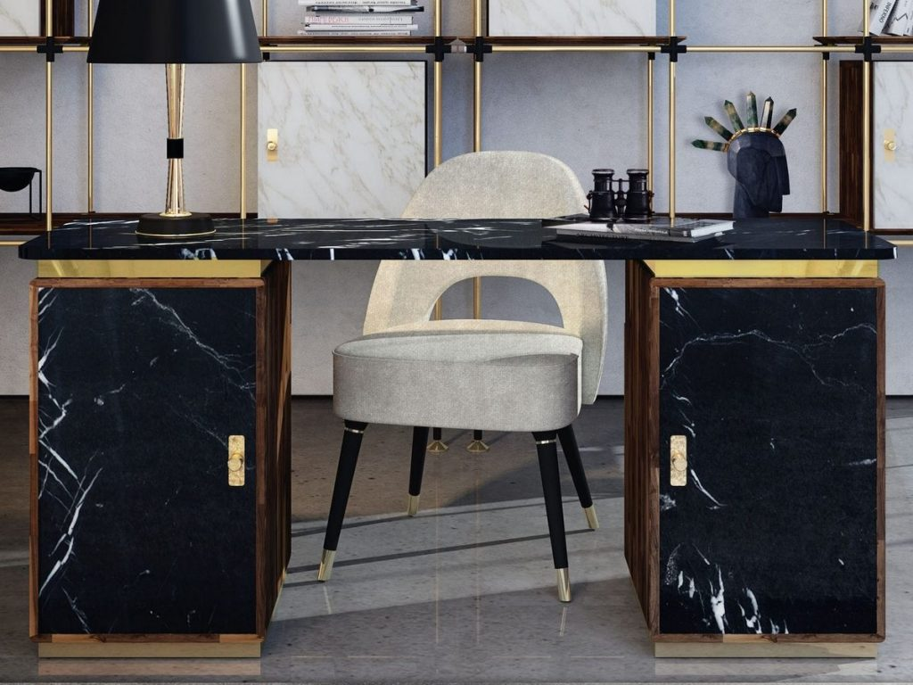 The Lasdun desk by Essential Home. This desk is made out of dark brown wood with black marble finishes.