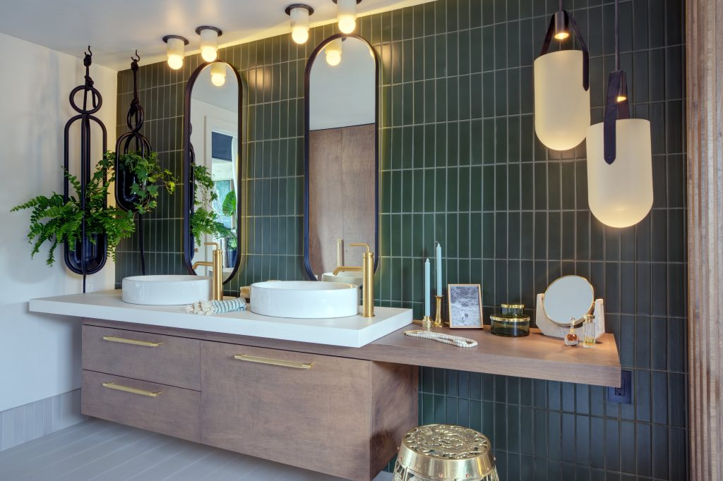 Hunters green bathroom tile with natural elements and gold finishes.