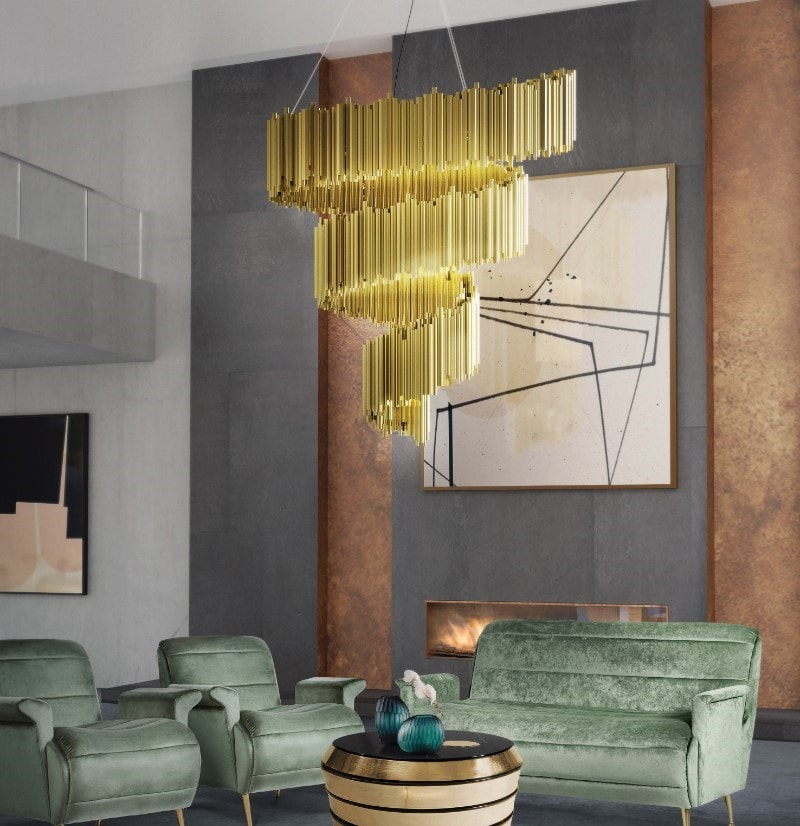 This living room has the Brubeck spiral lamp, which has gold and metalic finishes and is a spiral made out of small tubes.