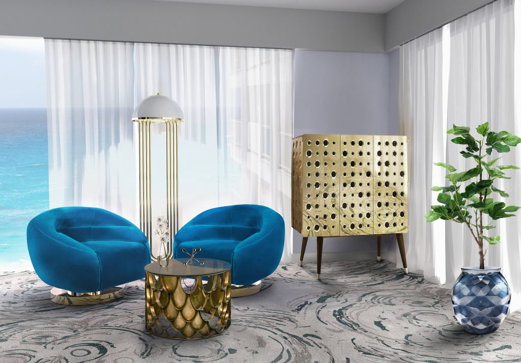 A seating area with golden furniture and bold, blue armchairs.