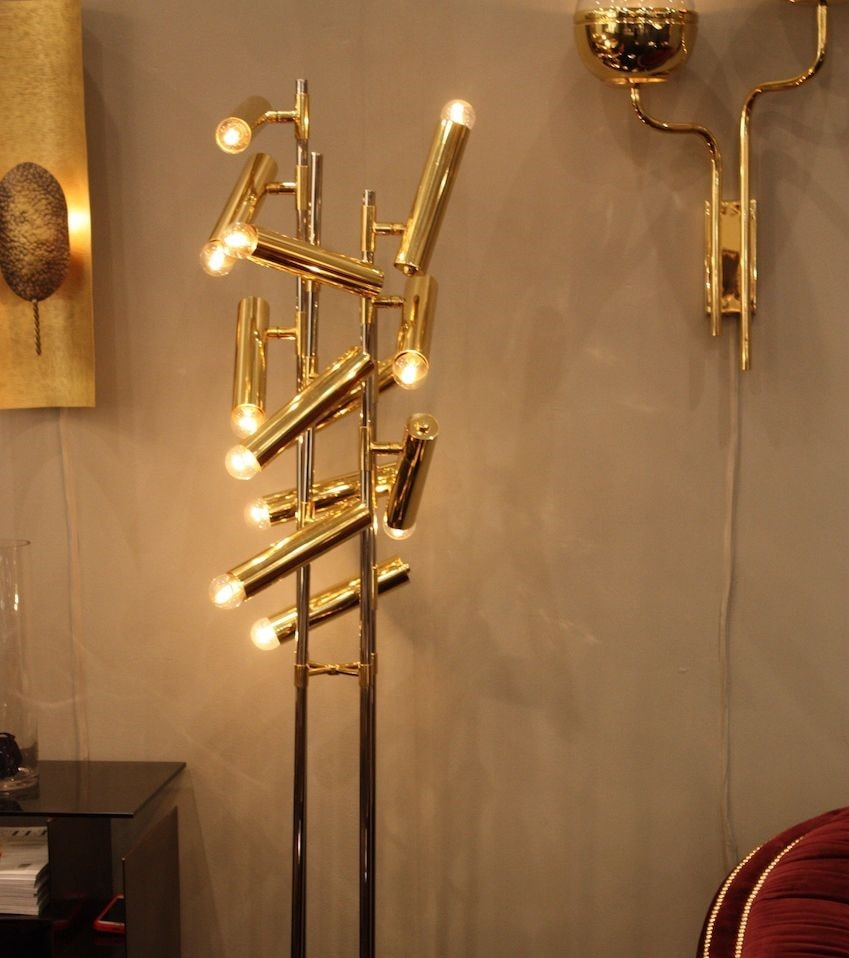 The Cypres floor lamp resembles the tree cypres and has as many lamps as a small tree could have all in gold.