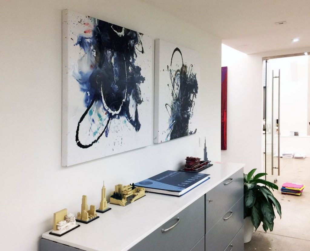 Abstract paintings in an office.