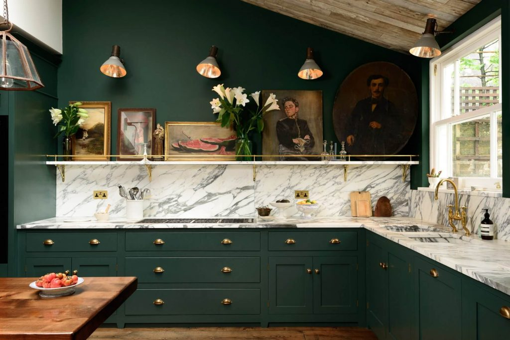 Forest green kitchen with marble and gold finishes