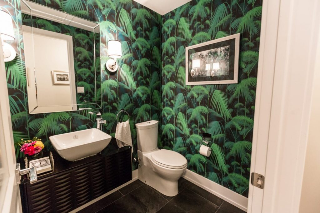 A bathroom trend in green plant wallpaper.