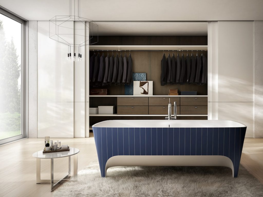 A bathtub before a big closet.