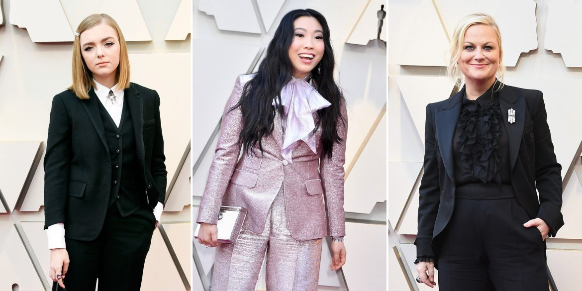 Ellie Fisher, Awkwafina and AMy Poehler in pantsuits.