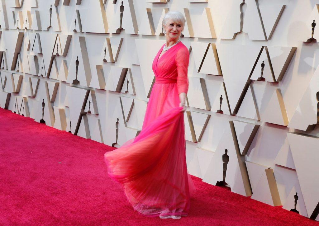 Helen Mirren in a pink tulle Schiaparelli gown.