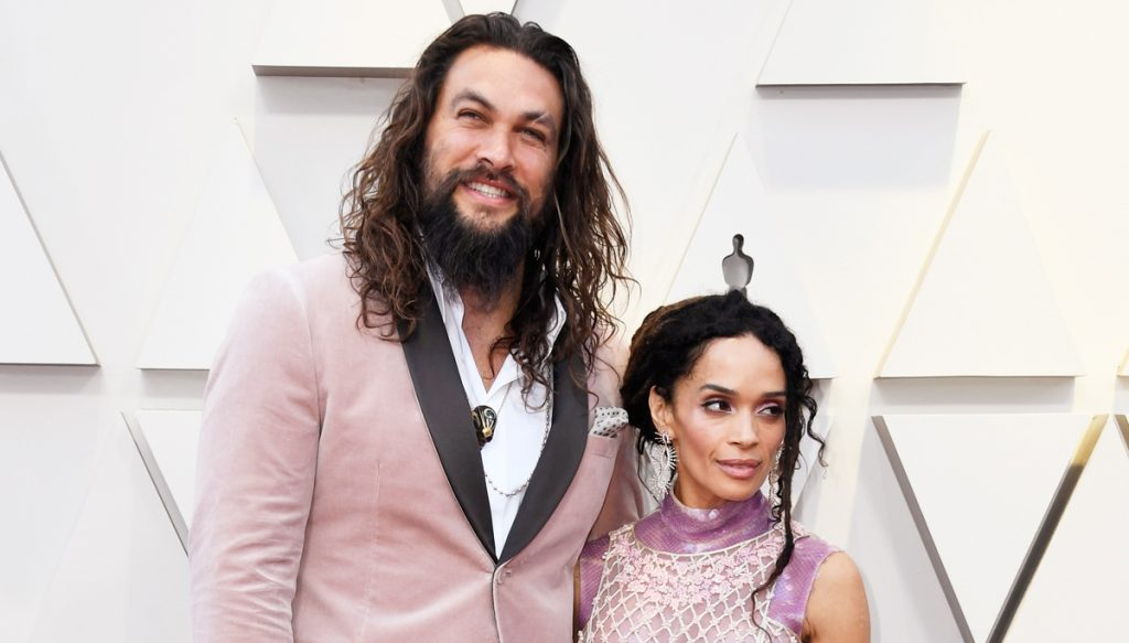 Jason Momoa in a velvet Karl Lagerfeld suit with his wife Lisa Bonet in a matching dress.