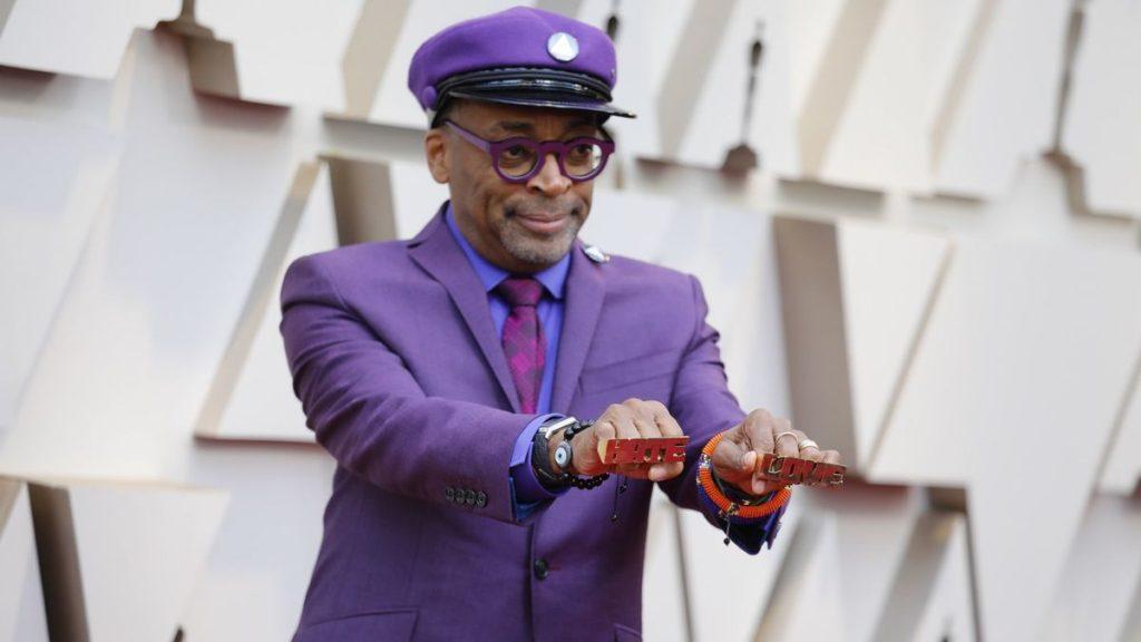 Spike Lee in a purple suit in memroy of Prince.