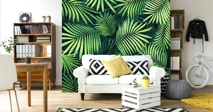 Living room with white walls and one wall with green ferns wallpaper.