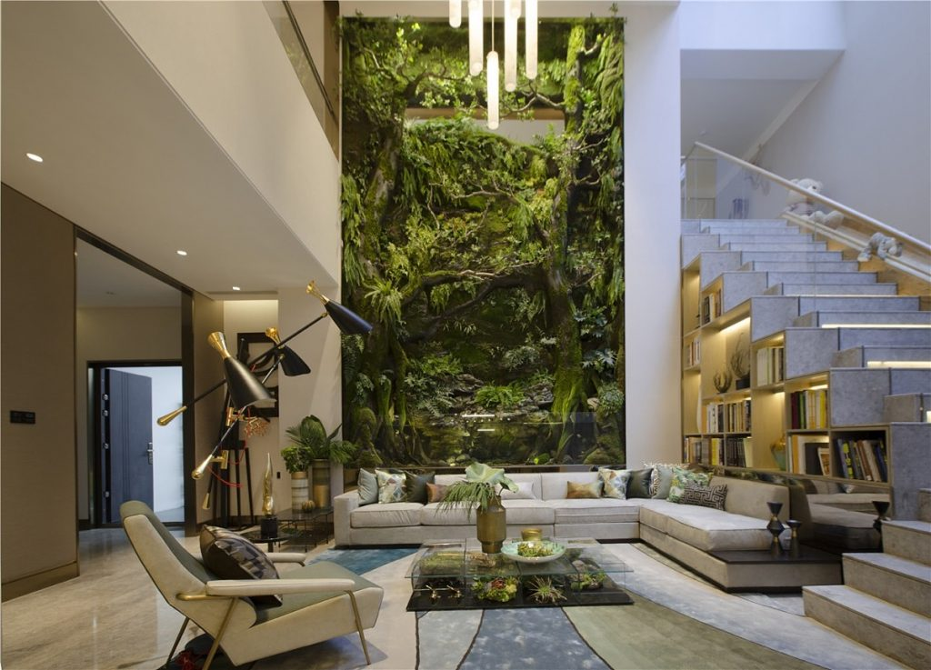 Biophilia in interior design. Living room with big garden inside.