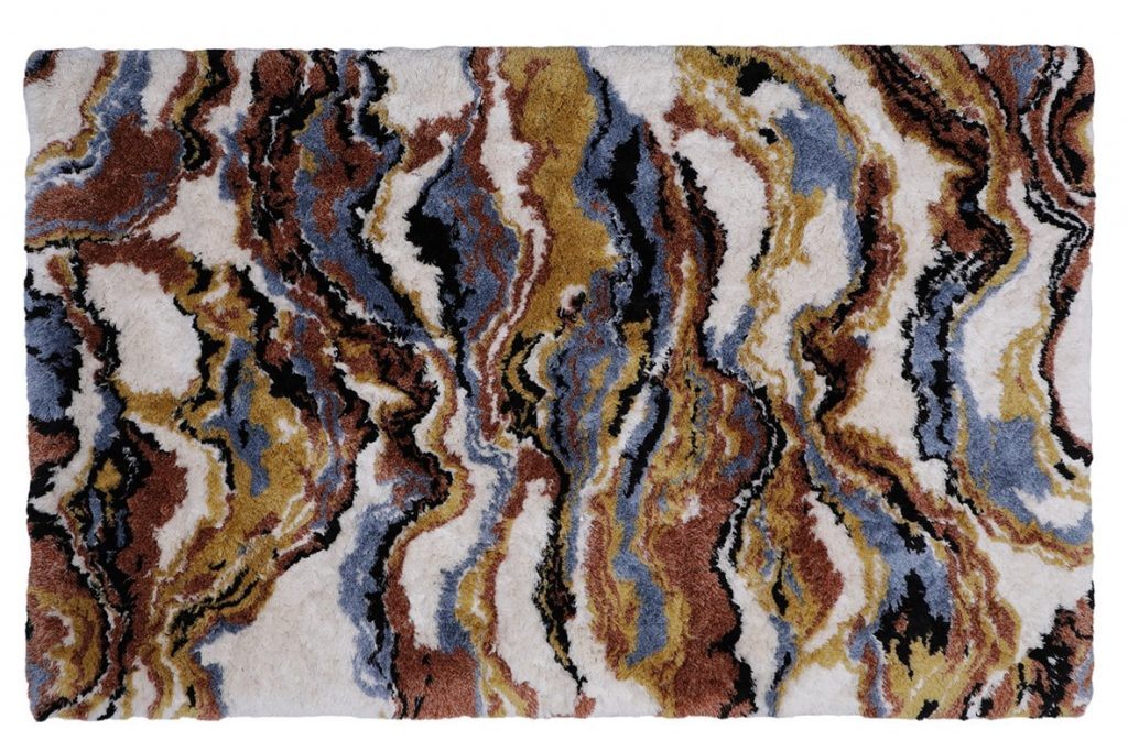 The La land rug of Rug' Society has a swirling pattern in brown, blue, black and yellow.