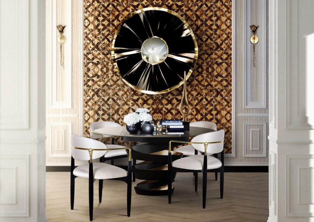 This small dining area houses four Nahéma chairs by Koket. The Nahéma chair has white seating cushions black legs and gold finishes in the form of hands.