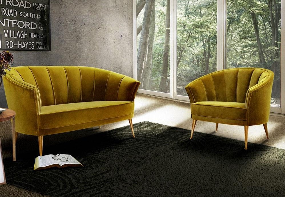 This living room has  yellow sofa's and the black Surma rug by Brabbu which has a spiral pattern.