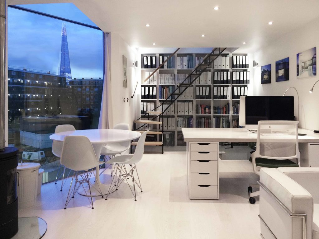 An modern office, which looks out on the Shard in London.