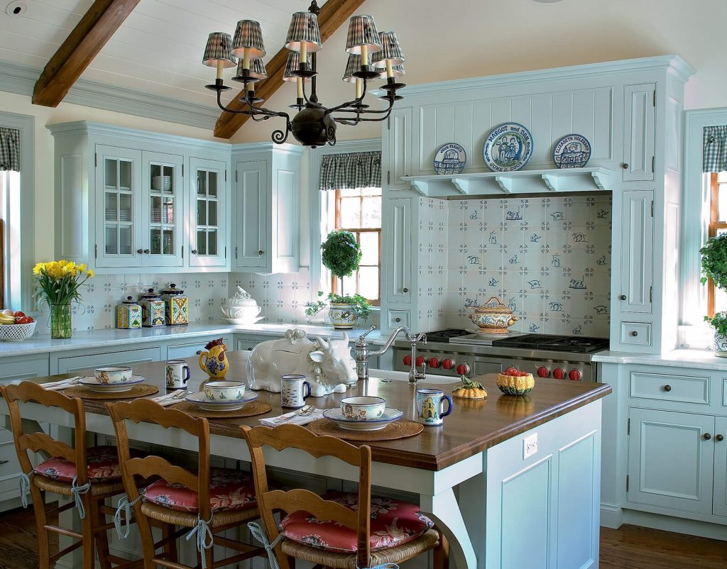 A farmhouse style kitchen with egg blue cabinets.
