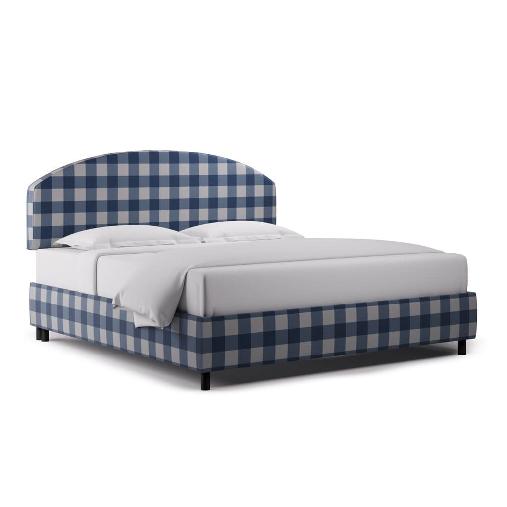 The luxury bed Demilune by the Inside in a french blue and white checker pattern.