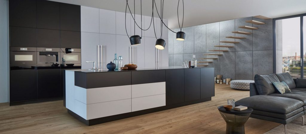 A black and white modern open concept kitchen.