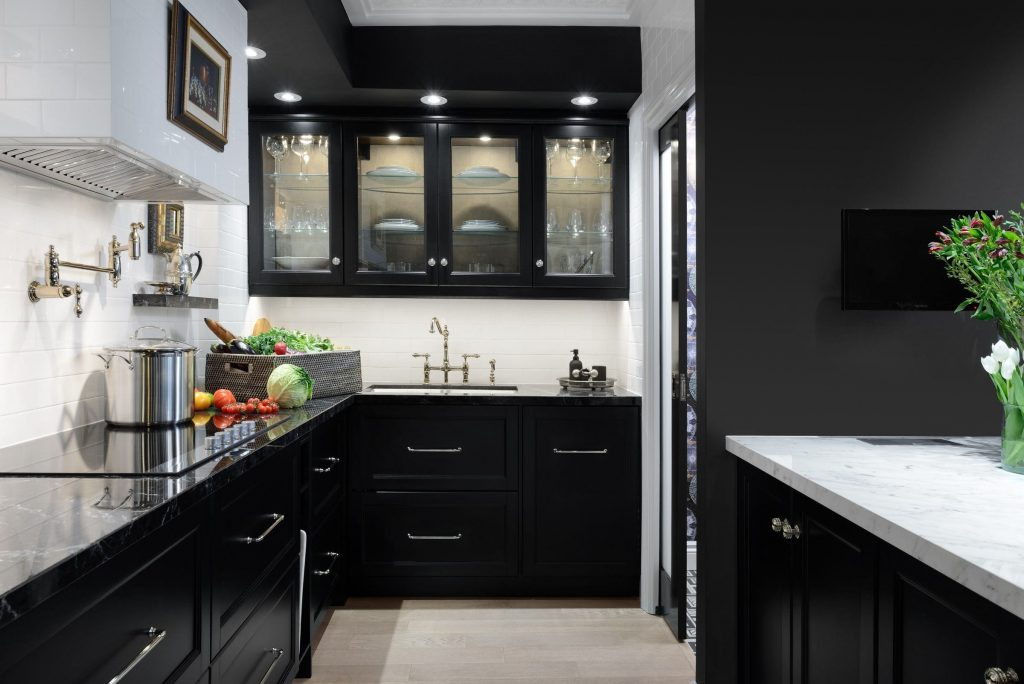 A black colour is a nice contrast with the white already present in the kitchen.