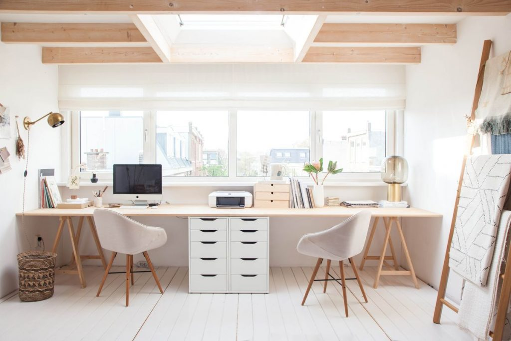 A light, bright office with wooden accents.