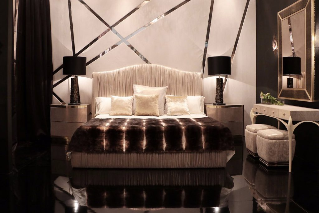 A luxury bed in a showroom by KOKET.