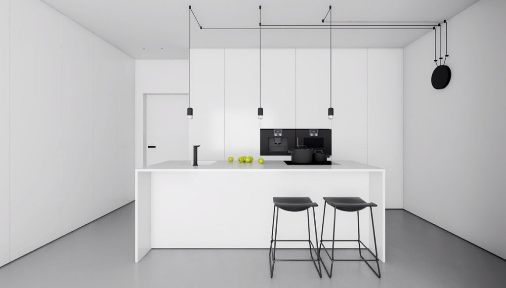 A minimalistic kitchen in white with black accents on the chairs, oven and cooker.