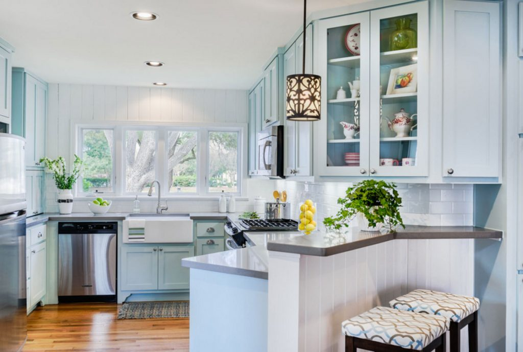 A pale blue colour adorns these kitchen cabinets.