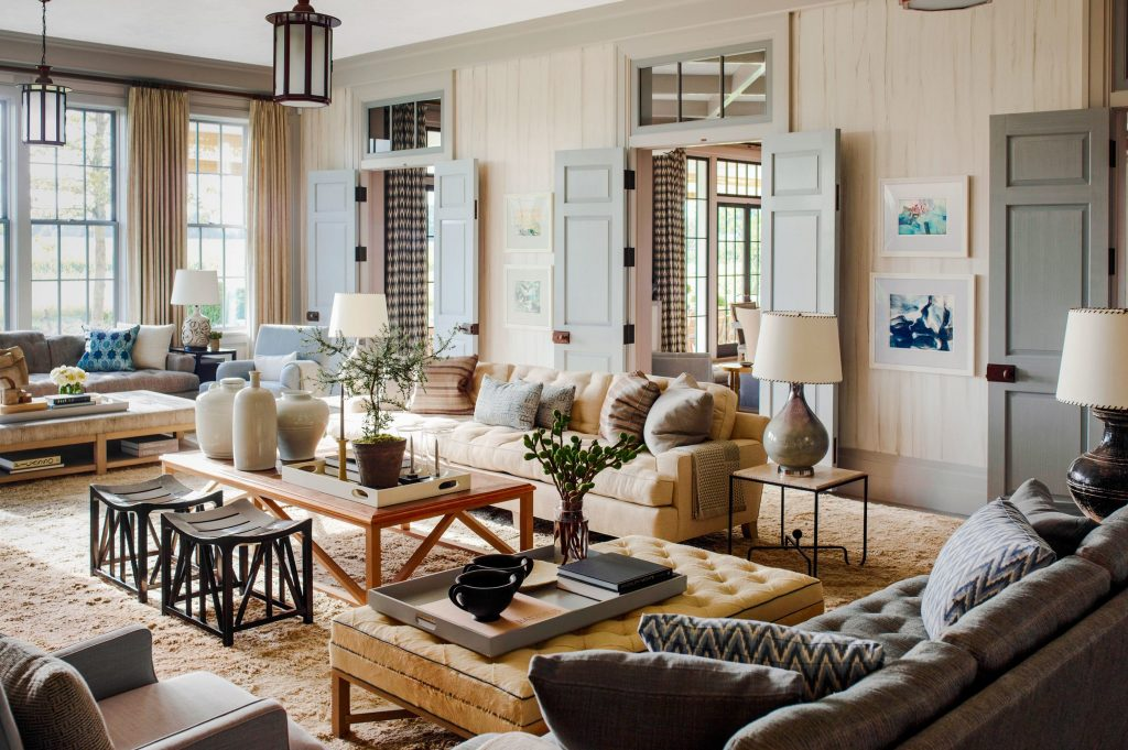 A beautiful farmhouse styled living room by American interior designer Steven R. Gambrel.
