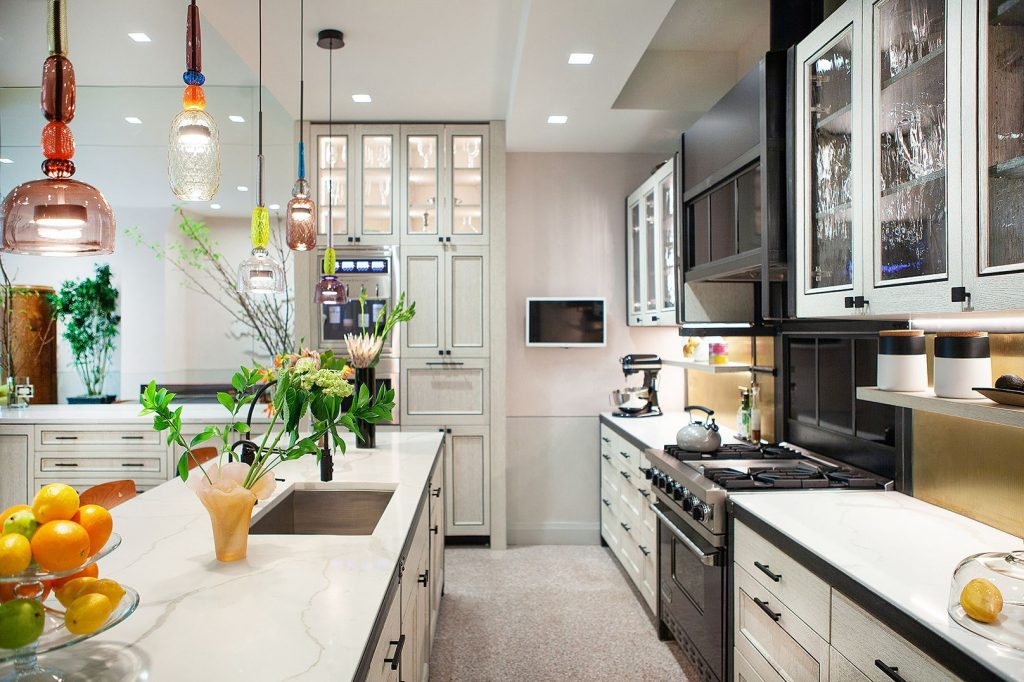The kitchen of Carolyn's luxury home has lamps that have influences from other cultures and are a wink to her travels.