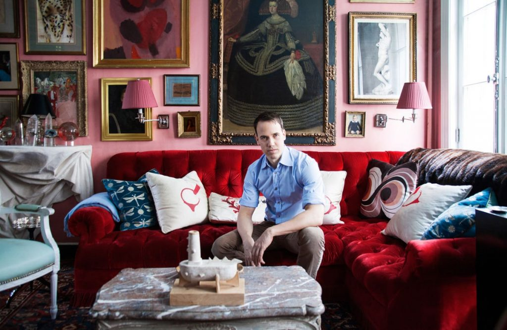 American interior designer, Miles Redd in his pink and red living room.