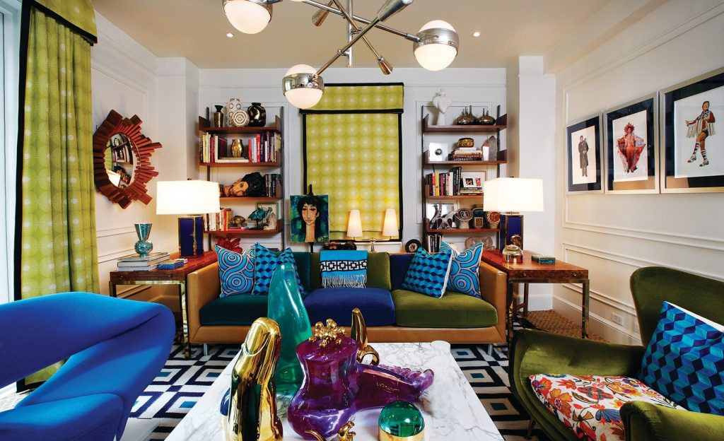 The living room of the luxury home by Jonathan Adler and Simon Doonan has their fun finds but also their sentimental finds.
