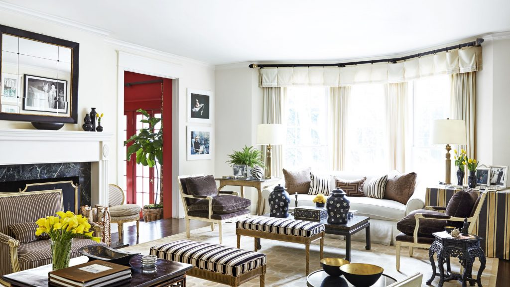 A beautiful black and white living room with golden accent by American interior designer Mary McDonald.