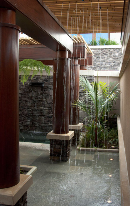 Tropical Bathroom with Shower in the Ceiling