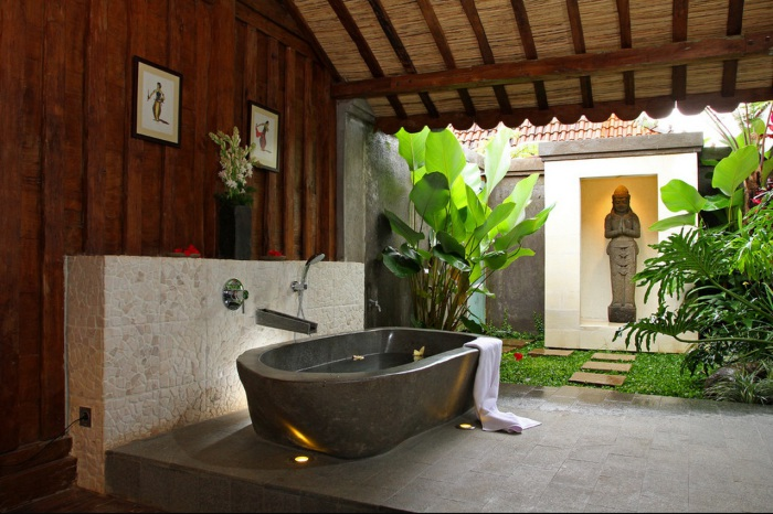 Tropical Bathroom with Granite Bath